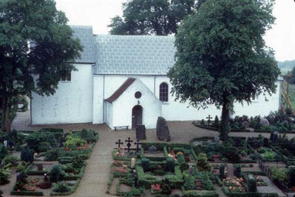 The current church with the Jelling rune stones in front of it.