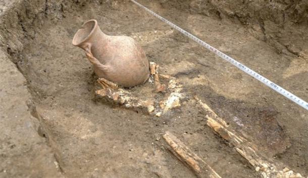 Two well preserved clay jars were place at the head and feet of the man. (Russian Highways)
