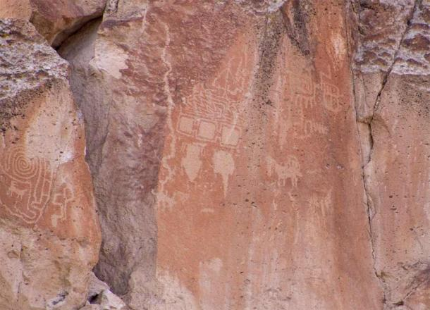 Located high up on a cliff face, the three squares in the center of the image have been interpreted as the three worlds of Fremont cosmology (underworld, material world, and upper world); Fremont Indian State Park. (Photo © John Lundwall)