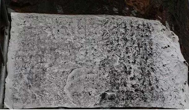 A close-up of a section of the carving (in the process of taking a rubbing, which researchers say tells the story of China's ancient military might. Photo: