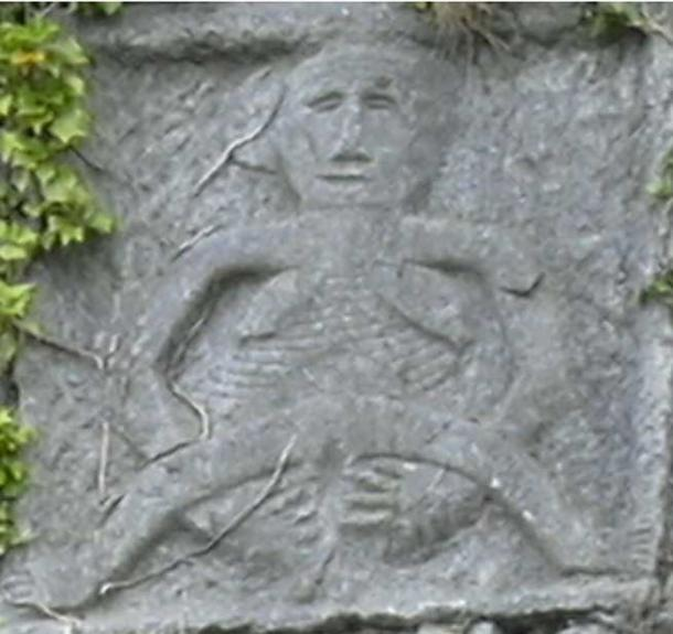 This is a close-up of the Sheela na gig on the side of Dunaman Castle, Ireland