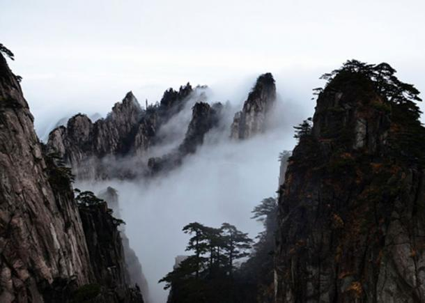 When the clouds roll in the mountaintops look as though they are islands floating in a sea of mists.