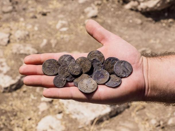 The cache of silver coins found at the estate house.
