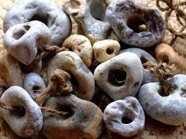 A collection of threaded Adder Stones.