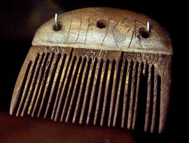 A comb made of antler from around 150 to 200 CE and was found in Vimose on the island of Funen, Denmark. The Elder Futhark inscription reads