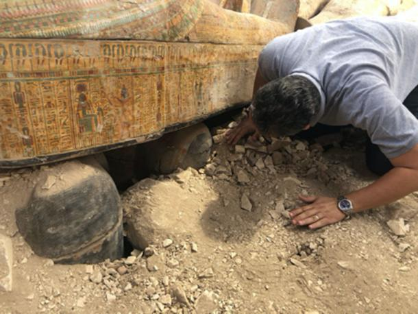 Minister of Antiquities Khaled el-Anany looking at recently discovered ancient colored coffins. (Ministry of Antiquities)