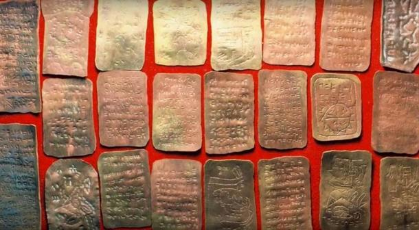 Copper plates purportedly discovered in the Brewer Cave. (Terry Carter / YouTube)