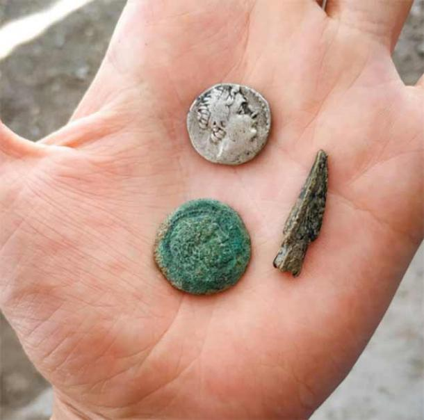 Silver and copper coins of Euthydemus I and a bronze arrowhead. (Institute of Archaeology RAS)