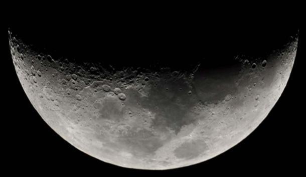 Upward-opening crescent Moon.