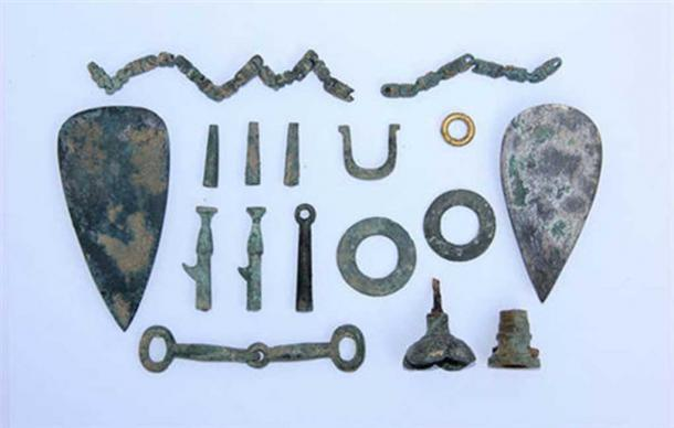 Some of the cultural relics found when Chinese state archaeologists excavated the site, called Yongshan Blood Pool.