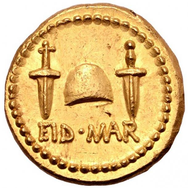 """Two daggers and the words """"EID MAR"""" depicted on the rare assassination coin of Julius Caesar. (Numismatic Guaranty Corporation)"""