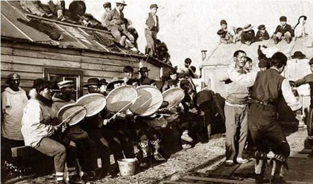Iñupiat dance near Nome, Alaska, 1900 in which offerings are made to the fart god.