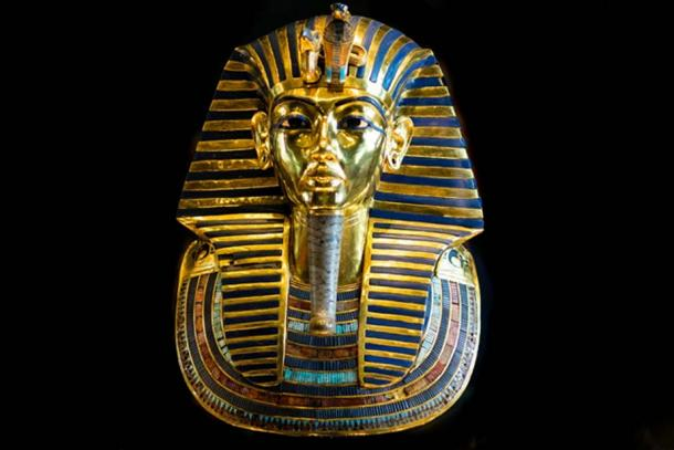 The dazzling golden mask that was found on the mummy of the boy-king Tutankhamun. The headpiece is embellished with inlays of both glassy material and a range of semi-precious stones. These include obsidian and white quartz (for the eyes), lapis lazuli (for the eye surrounds and eyebrows), and turquoise, amazonite, carnelian, and other stones (as inlays of the broad collar). Egyptian Museum, Cairo.
