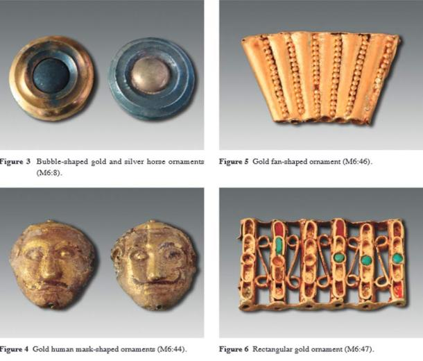 Some of the decorative items found in the largest tomb include these items as described in the journal Chinese Archaeology.