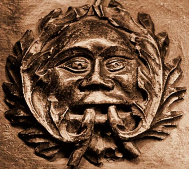 Detail of a 'disgorging' Green Man medieval misericor in Ludlow parish church. (Public Domain).