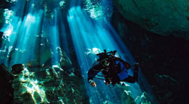 A diver in a Yucatan cenote.