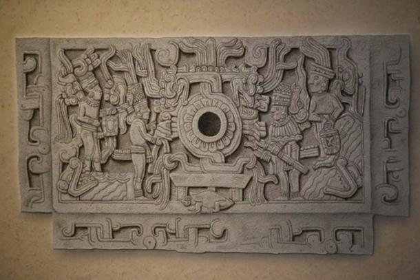 An old drawing of the same bas-relief from which all the elements of the mythical composition can be fully appreciated. Two sets of figures stand on the opposite sides of a rotating device, around which coil two entwined serpents. The central pole symbolized the world axis, supported by the turtle – symbol of the earth and perhaps of the constellation of Orion. The stormy sea is depicted in the lower left and right corners, with the mouths of sea monsters jutting out of it. Two figures stand on the opposite ends of the bas-relief carrying curious handbags believed to contain the nectar of immortality. (Courtesy INAH – Museo del Sitio El Tajin)
