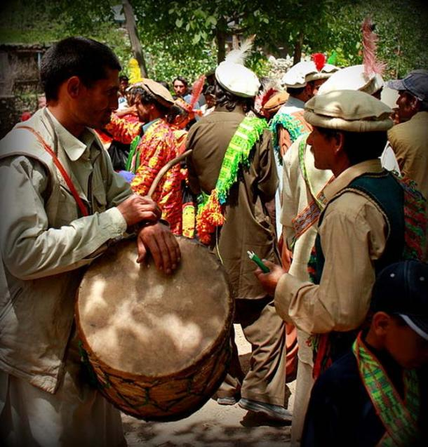 A drummer during the Joshi festival in Bumberet, Pakistan. Drumming is a male occupation among the Kalash people.