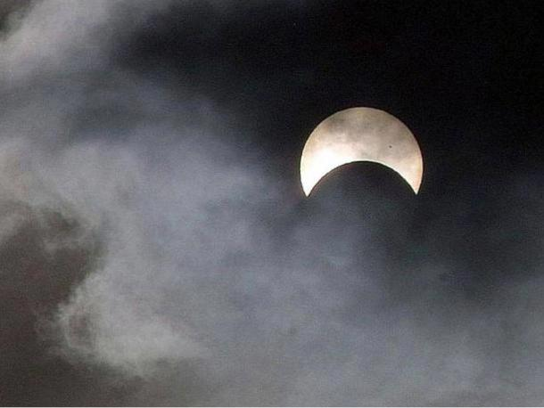 The eerie sight of a partial eclipse of the sun.