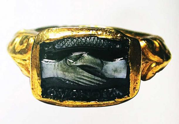 An elaborate gold and onyx Roman wedding ring from the 3rd century.