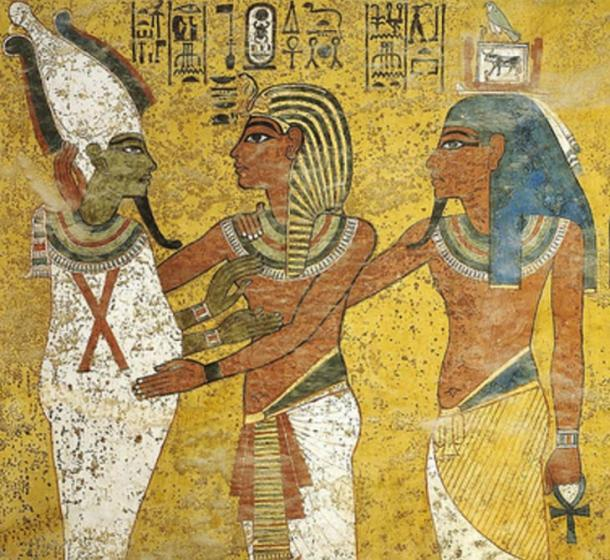 Detail; Pharaoh Tutankhamun embracing god Osiris, scene from the tomb of Tutankhamun, KV62.