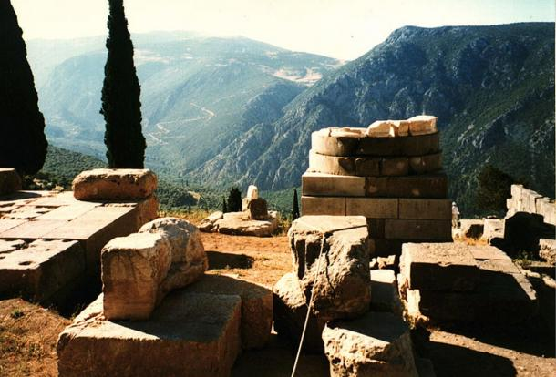 The empty base of a serpent column at Delphi.
