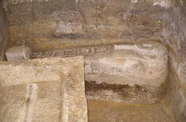 An engraved stone sarcophagus found in the burial chamber.