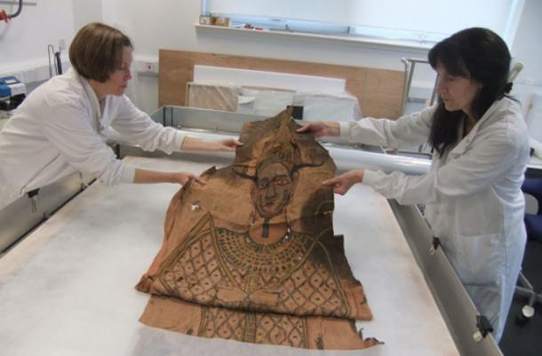Researchers examining the shroud.