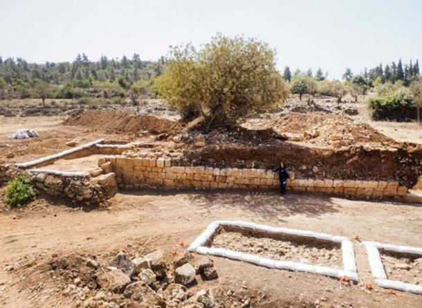 The excavation area and the collapsed wall where the Byzantine coin hoard was found.
