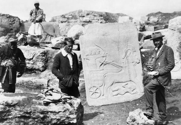 T E Lawrence with Leonard Woolley, the archaeological director, with a Hittite slab on the excavation site at Carchemish