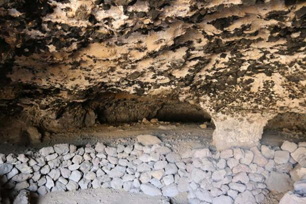 The two images above show some of the caves present extensive burn marks on the walls and ceilings, which testify of a long and intense ritual activity.