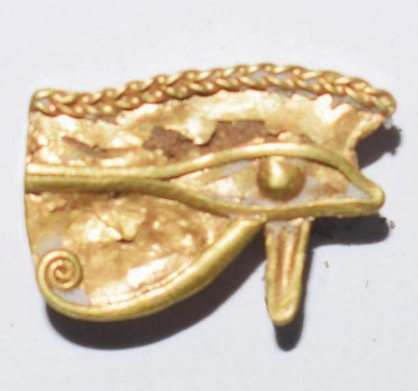 The pure gold eye of Ujat found in the mound. Credit: Ministry of Tourism and Antiquities