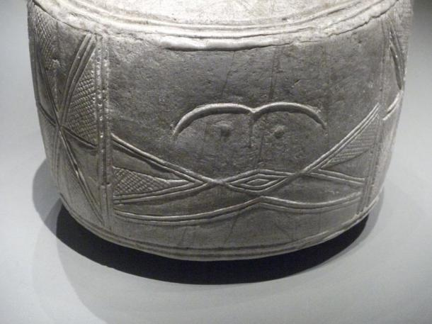 A stylized face on one of the drums; researchers do not know what the drums were used for.