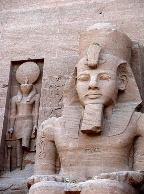 The falcon-headed sun god Re-Horakthy is depicted to the left of Ramesses II at Abu Simbel in Egypt.