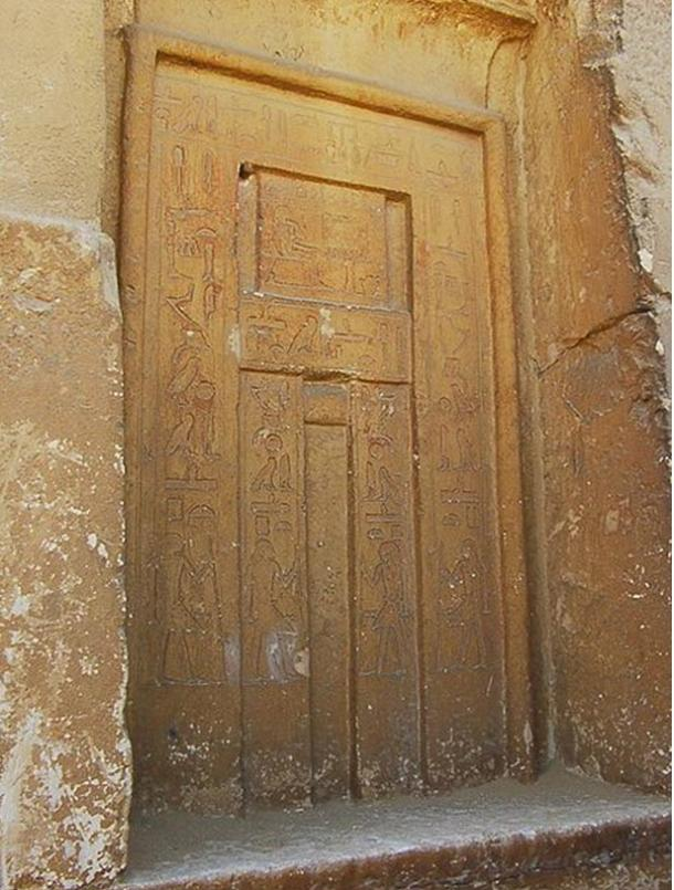 False door with depiction of tomb owner sitting in front of an offering table (rectangular section in top half of door).