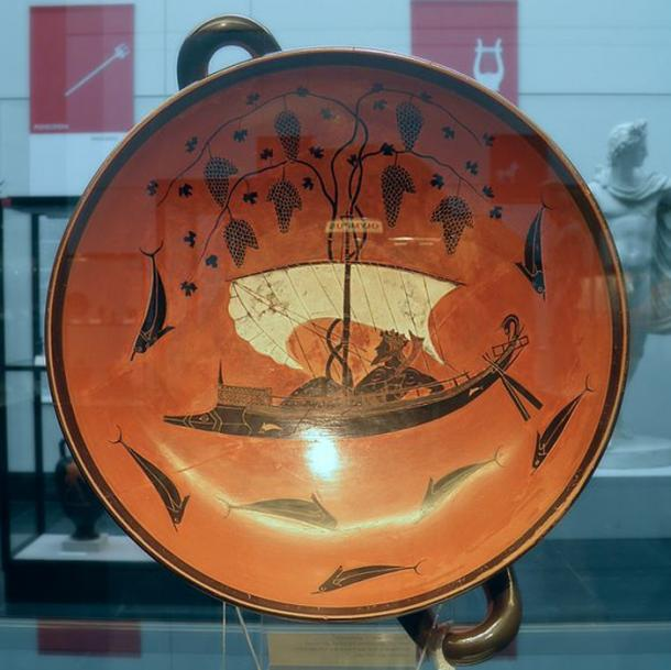 A famous black figure kylix by Exekias. It depicts the god of wine, Dionysus, on a ship. A myth says that pirates tried to abduct him but he transformed them all into dolphins and made vine leaves spring from the mast to act as sails.