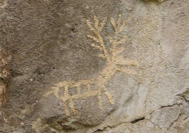 The most famous of the Lipci primitive rock paintings is this one showing male stag deer (and one doe) and men on horseback. (Montenegro For Me)