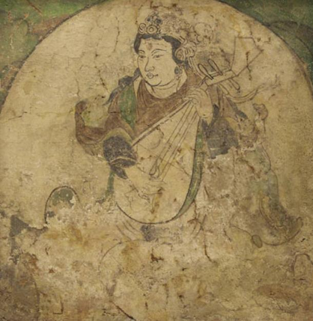 A feitian playing pipa, wall painting from Kizil, pigment on stucco, Tang dynasty, 600-800.