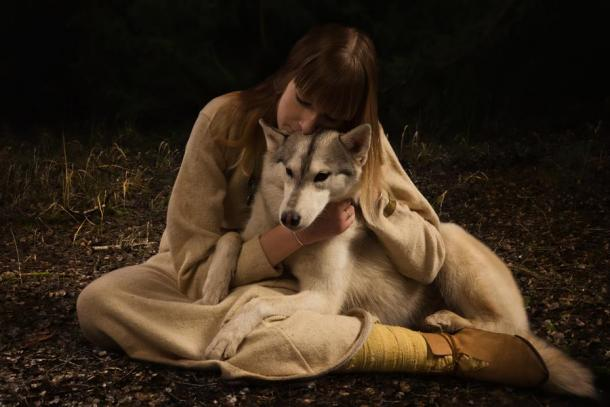 Woman with arctic dog. Source: Demian / Adobe Stock