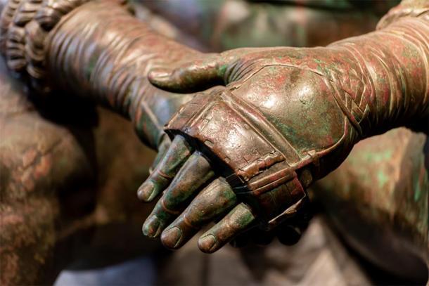 Details of an ancient Roman bronze statue. Credit: giorgio / Adobe Stock