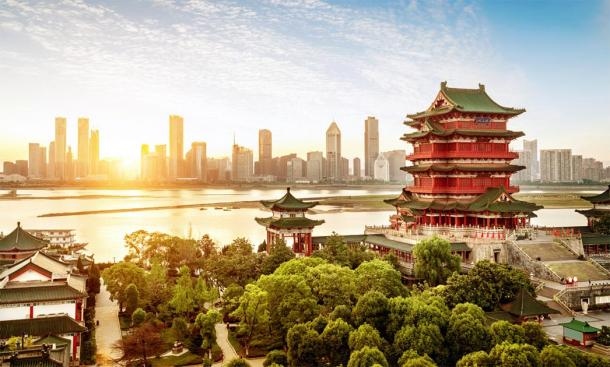 Ancient capitals of China. Representation of classic ancient Chinese architecture with a modern cityscape in the background.  Source:  gui yong nian / Adobe stock