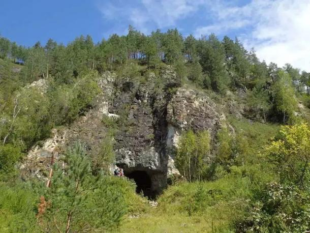"""The entrance to the Denisova cave in the Altai Mountains of Siberia where the so-called new """"Denisova Cave DNA"""" has proven, for the first time, the Neanderthals, Denisovans and Homo sapiens occupied the same cave at the same time sometimes!   Source: Professor Richard G. Roberts / University of Wollongong  By Ashley Cowie"""