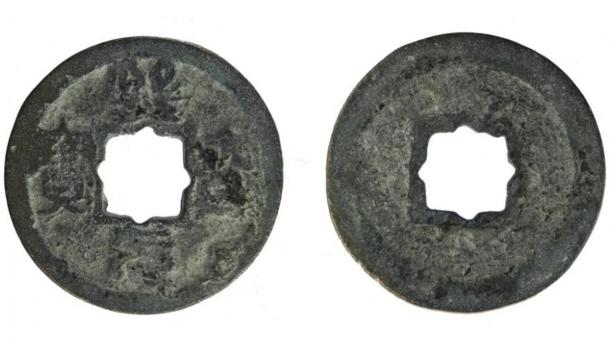 The worn cast copper alloy Chinese coin, from the Northern Song dynasty (960 AD to 1127 AD), minted during the Xining reign between 1068 and 1077 AD, and found in Britain