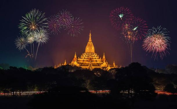 Fireworks over a golden temple.