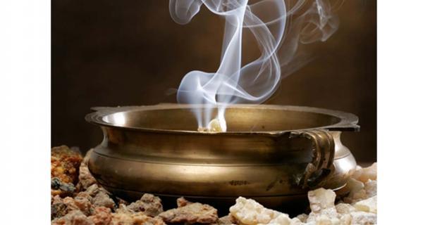 A copper bowl burning frankincense.