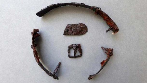 A buckle and part of a strap were found with the metal pieces. Credit: Border Archaeology