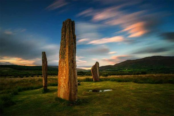 Machrie Moor on the Isle of Arran at sunset with two magnificent standing stones in the foreground. Source: swen_stroop / Adobe Stock