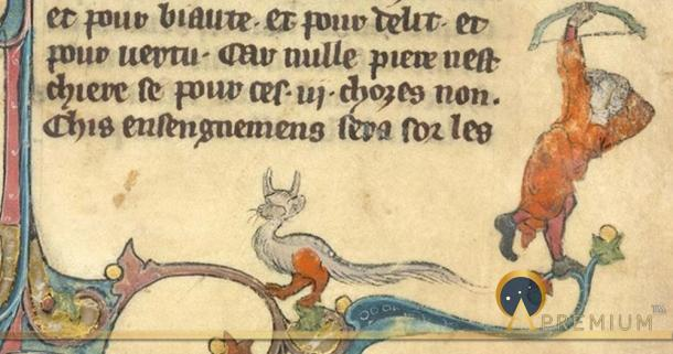 Lower right part of the three-sided border: an archer shooting at a dragon, and a grotesque, in Brunetto Latini`s Le Livre du Trésor. (circa 1315-1325)France, N. (Picardy) (Public Domain)