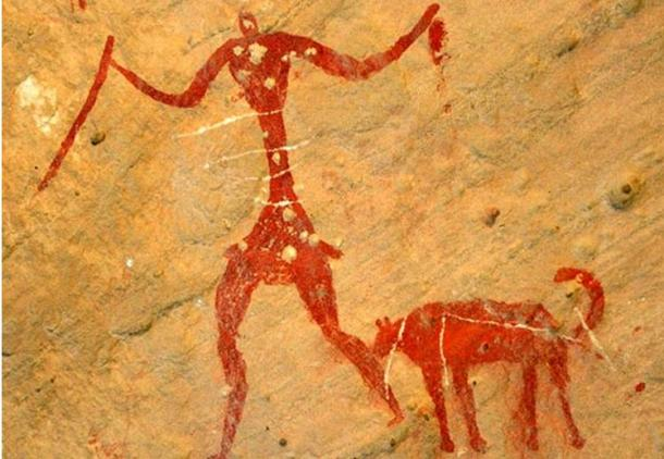 A rock painting possibly depicting a person with a dog.