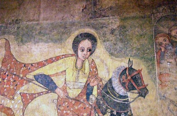 A figure rides upon horseback, thought to be the Queen of Sheba.